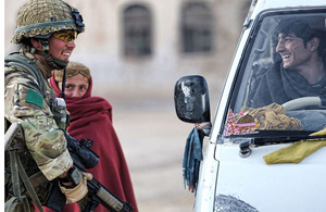 A soldier from 3 PARA talks to a young motorist in Naqilabad Kalay about career opportunities in the Afghan National Police