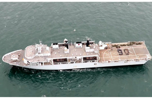 "The crew of HMS Bulwark form a ""90"" on her flight deck."