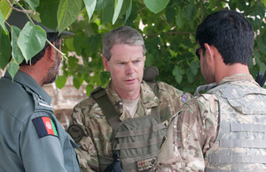 Lieutenant General Adrian Bradshaw speaks with members of the Afghan National Security Forces