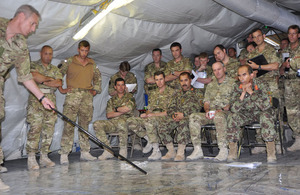 British and Afghan military personnel during the planning stages of Operation OMID HAFT