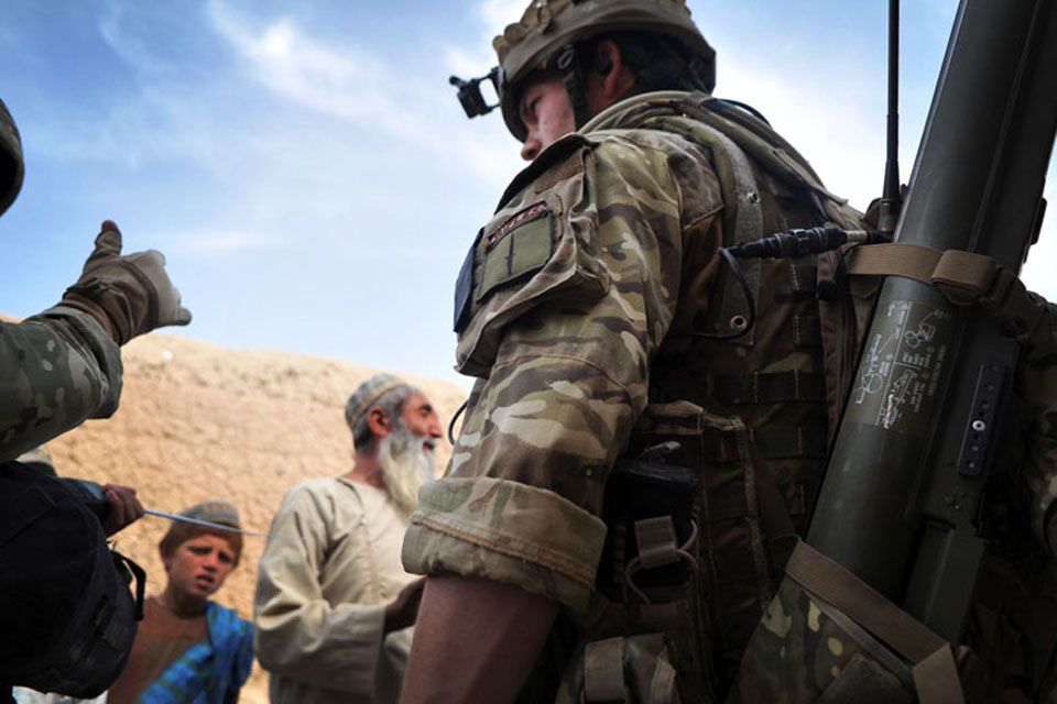 Soldiers from 1st Battalion The Rifles speak with villagers following their helicopter insertion into the town of Alikosi in Helmand province