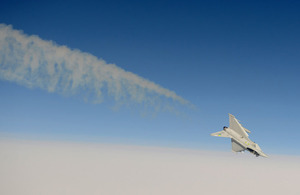 An RAF Typhoon from RAF Coningsby displays its agility above the clouds (stock image)