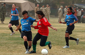 Afghanistan's national women's football team play a friendly match against a team of women from ISAF headquarters in Kabul