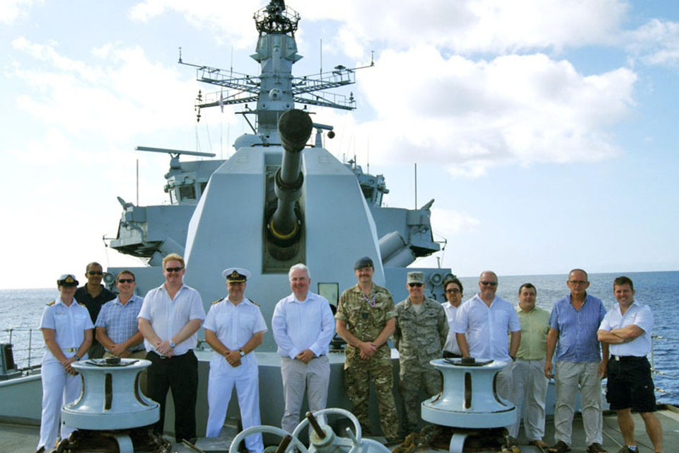 Key figures from the Ascension Island community on board HMS Montrose with the ship's Commanding Officer