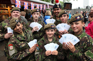 Members of the North East London Army Cadet Force display some of the Thames Jubilee Pageant information leaflets that they were distributing