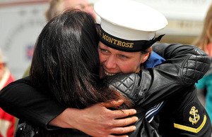 A sailor from HMS Montrose is welcomed home by a loved one in Plymouth