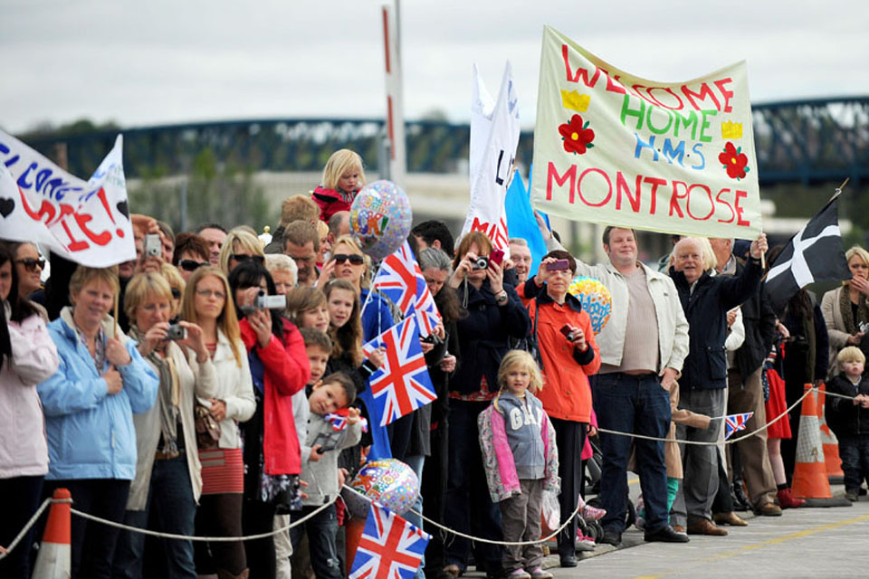 Crowds of families and friends await loved ones returning to Plymouth on board HMS Montrose