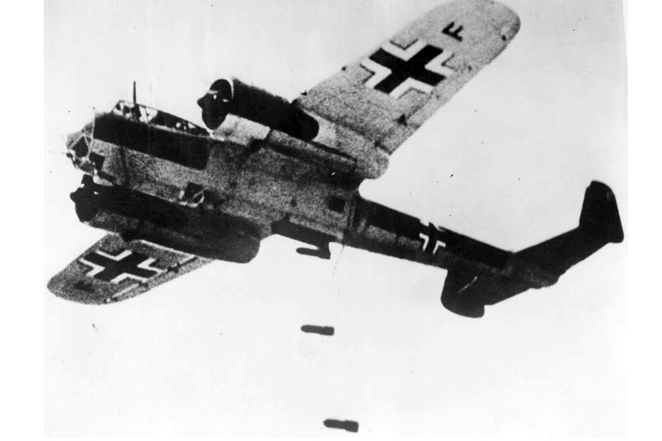 A Dornier 17 delivers its payload of bombs