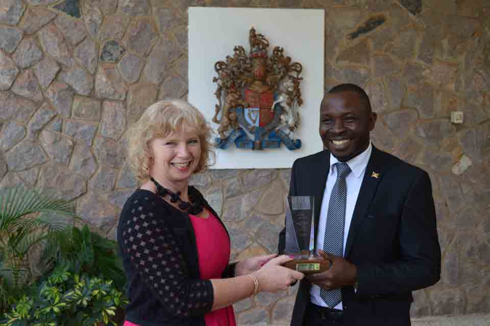 HE Alison Blackburne presents the prestigious Lord Astor Award to Robert Sempala.