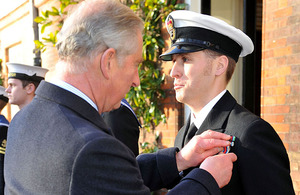 A member of the Commando Helicopter Force receives his Operational Service Medal for Afghanistan from His Royal Highness Prince Charles at Clarence House in London