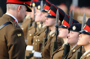 Brigadier Ian Cave talks to Junior Soldier Megan Davies on parade at the Army Foundation College Harrogate