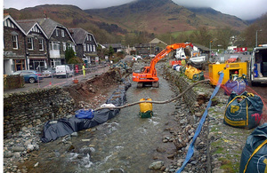 Digger in river at Glenridding, Cumbria