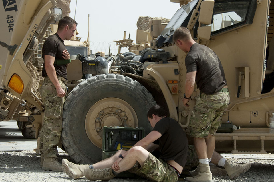 Engineers from 45 Commando's Light Aid Detachment prepare to get to work on a Husky in Helmand