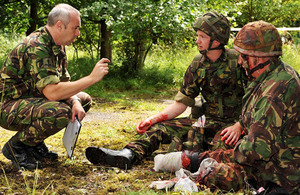 Real amputees act the part of battlefield casualties for the practical assessment stage of the team medic course at Merryfield Training Ground