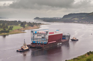 The mid-section of what will be HMS Queen Elizabeth's hull being transported down the Clyde from BAE Systems' shipyard in Govan, Glasgow