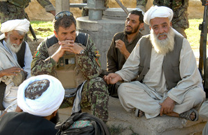 Afghan Army General conducting a shura with local elders in Saidan village near Gereshk