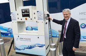 Minster Andrew Jones with a hydrogen refuelling station.