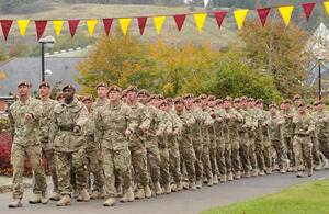 Soldiers from C Squadron of the King's Royal Hussars march into Aliwal Barracks on Tidworth Camp