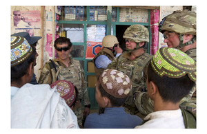 Mr Michael O'Neill, Head of Helmand Provincial Reconstruction Team, is given a tour of Naqilabad and Showal in northern Nad 'Ali by Royal Marines of 42 Commando