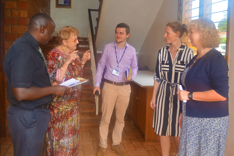 British High Commissioner HE Alison Blackburne and Deputy High Commissioner Mary Shockledge are taken on a tour of the Hospice Africa facilities by Founder, Dr Anne Merriman