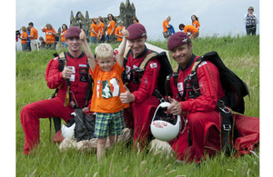 Four-year-old Henry gives a thumbs-up for the Red Devils Parachute Regiment display team