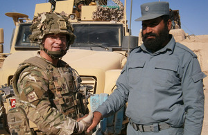 Warrant Officer Class 2 Terry Thompson, 1st Battalion The Princess of Wales's Royal Regiment, with the commander of Checkpoint Naeem in Babaji, Bor Agha