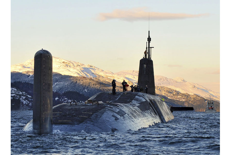 Nuclear submarine HMS Vanguard arriving back at HM Naval Base Clyde (stock image)