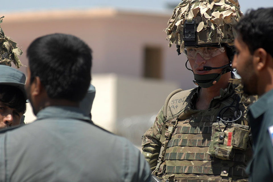 Lance Corporal Aiden Cooper, 253 Provost Company of the Royal Military Police, working with Afghan Uniform Police in Lashkar Gah as a police advisor