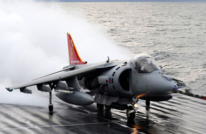 A Harrier GR9, tail repainted and emblazoned with the emblem of 800 Naval Air Squadron, prepares to take-off from the deck of HMS Ark Royal for the last time