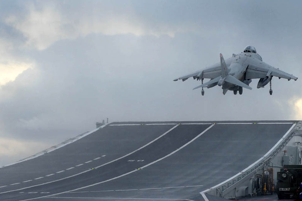 A Harrier GR9 belonging to 1 (Fighter) Squadron RAF launches off the deck of HMS Ark Royal for the last time