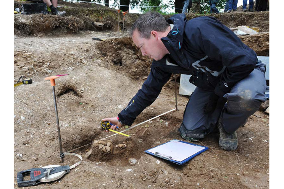 A soldier injured in Afghanistan carefully surveys and records Bronze Age and Anglo-Saxon deposits found during the excavation of Barrow Clump on Salisbury Plain