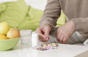 Elderly man with pills