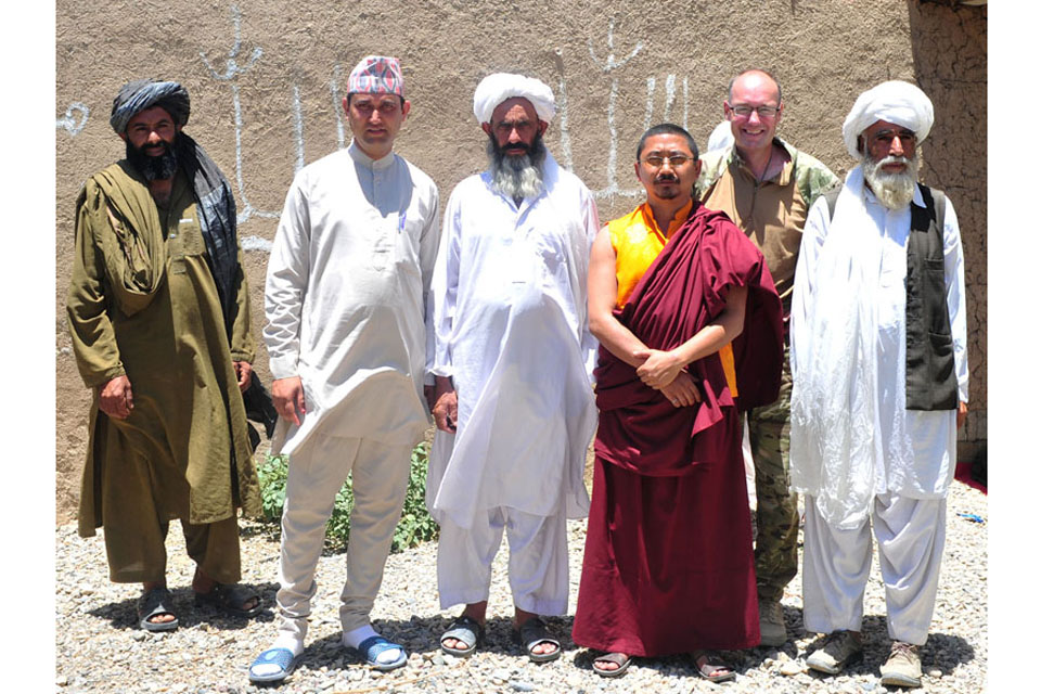 Religious leaders representing the Muslim, Christian, Hindu and Buddhist faiths attend a religious engagement shura at Chah-e Mirza in Nad 'Ali (South), Afghanistan