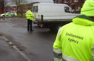 Image of police and Environment Agency officers on an operation
