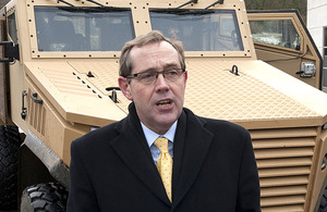 Peter Luff with a Foxhound armoured vehicle (stock image)