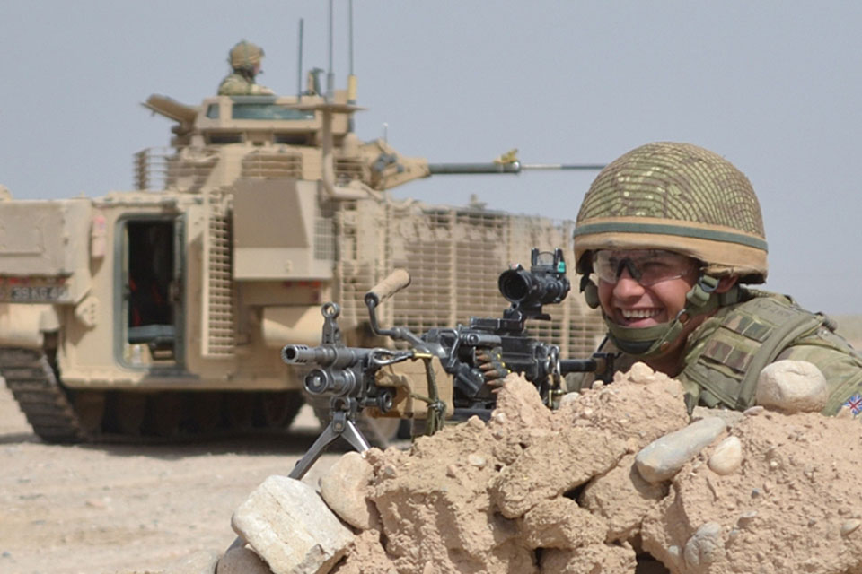 A British soldier with a new, up-armoured Warrior infantry fighting vehicle in Afghanistan