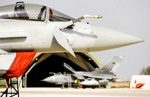 An RAF Typhoon aircraft, with a Tornado GR4 in the background, is prepared for a mission at Gioia del Colle air base