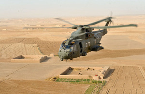 A Merlin helicopter from 1419 Flight providing air support for troops on the ground in Afghanistan