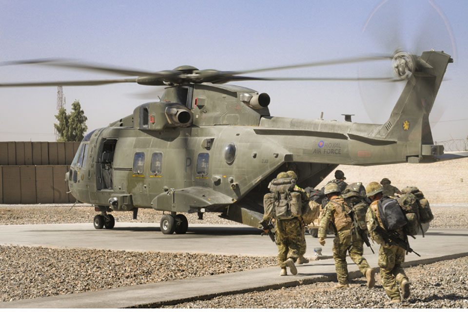 Troops embark on a Merlin helicopter at a patrol base in Afghanistan