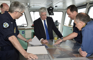 Vice Admiral Johnstone, Defence Secretary Michael Fallon and Captain Gardner (L-R) talking on the Bridge of RFA Cardigan Bay. Crown Copyright.