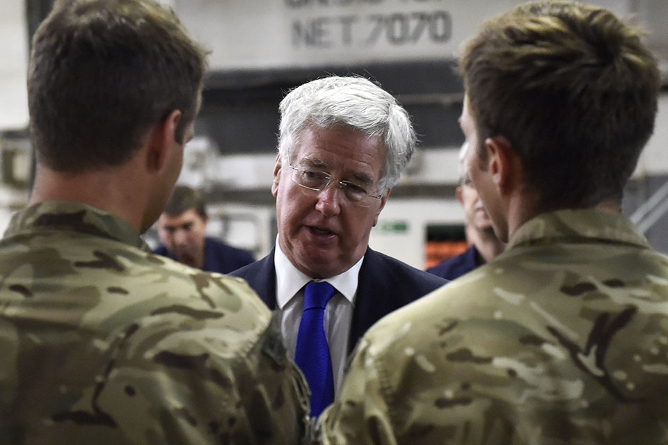 Defence Secretary Michael Fallon talking to Royal Marines on the Vehicle Deck on RFA Cardigan Bay. Crown Copyright.