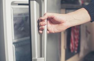 Opening a fridge.