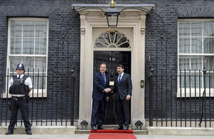 Prime Minister David Cameron and President János Áder of Hungary, shaking hands outside 10 Downing Street.