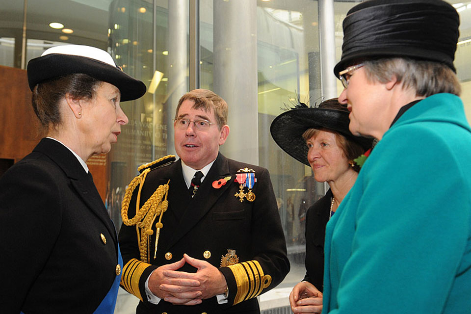 The Princess Royal speaks with First Sea Lord Admiral Sir Mark Stanhope and members of the Association of Wrens
