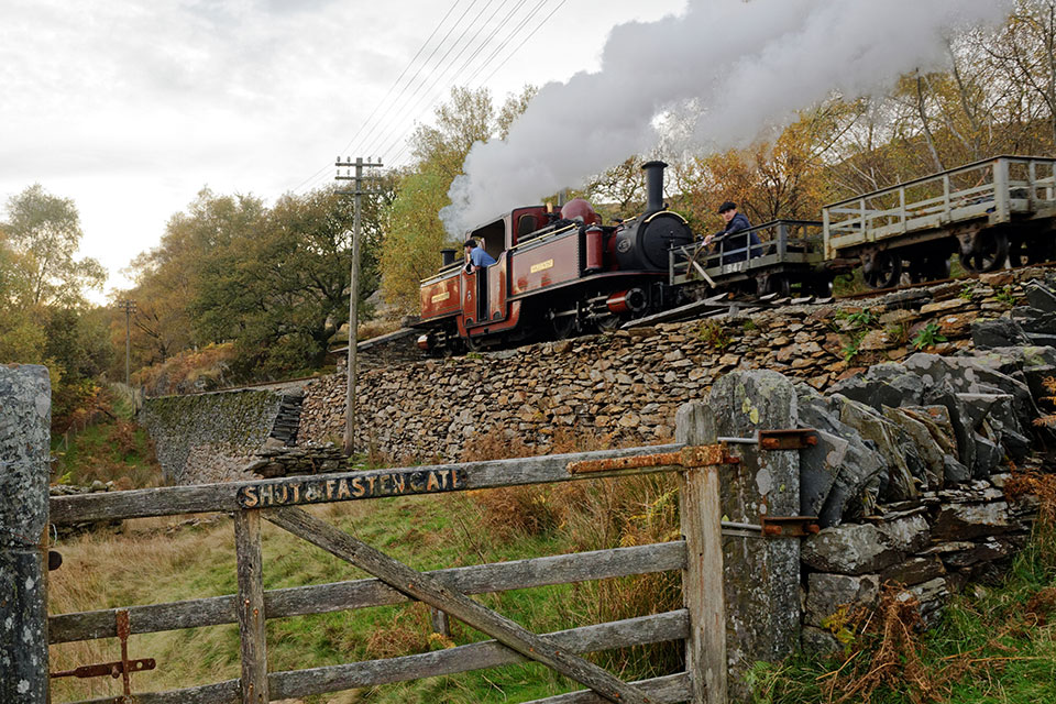 Steam train travelling in Wales.
