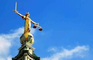 Photograph of scales of justice statue.