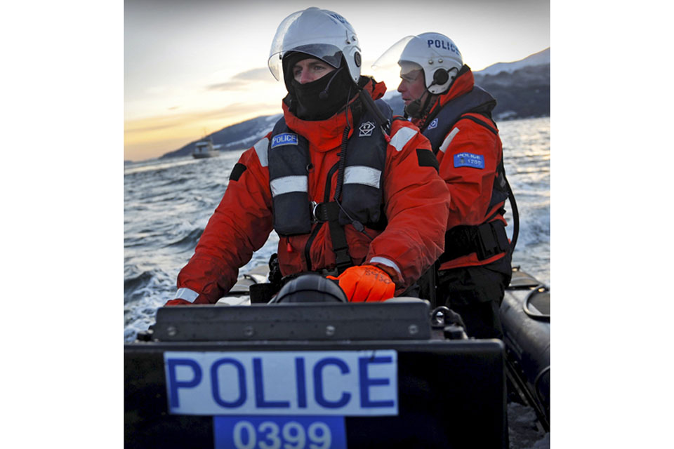 Members of Clyde Marine Police Unit escorting Royal Navy nuclear deterrent submarine HMS Vanguard back to HM Naval Base Clyde in Scotland (stock image)