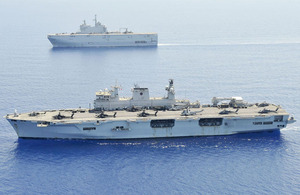 HMS Ocean (foreground) and Marine nationale's Mistral, off the coast of Libya