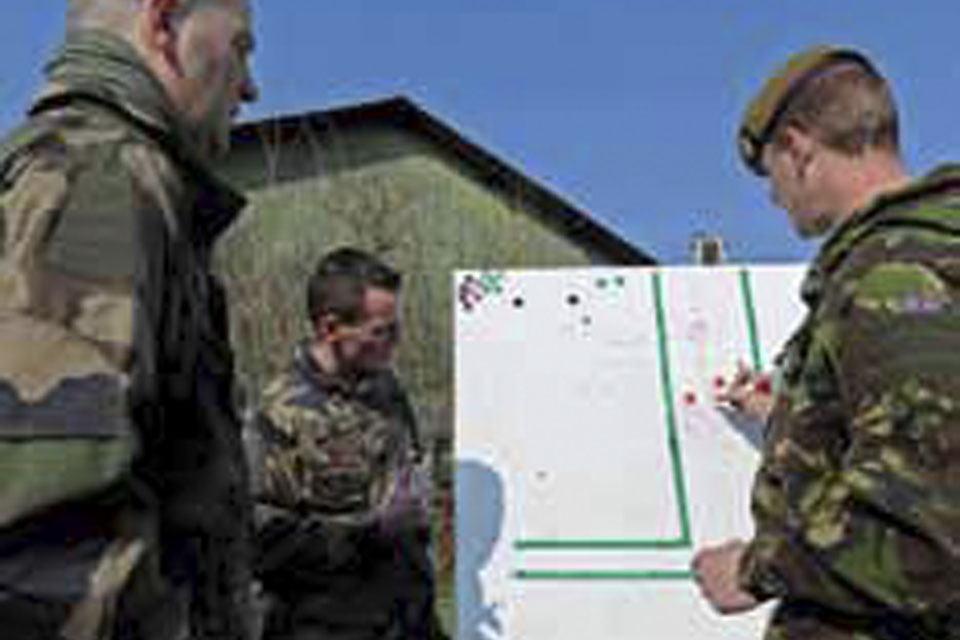 French Army instructors conducting lessons with British soldiers
