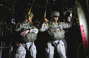 Members of the US Army's Civil Affairs and Psychological Operations Command (Airborne) ready to jump from a British Hercules C-130 over Salisbury Plain